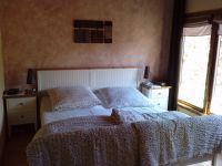 """Das größere Schlafzimmer mit Doppelbett - Bild 13: Ferienhaus """"Otto"""" in Garding auf Eiderstedt (4 Sterne lt. DTV)"""