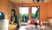Blick aus dem Wohnzimmer auf die Terrasse. - Bild 1: Bungalow C bei Blankenburg am Südhang mit Panoramablick
