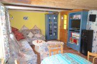 Wohn., Ess- und Küchenbereich mit Fußbodenheizung und Kamin - Bild 7: Haus am Bergflüsschen - Whirlwanne - Garten - Pool - Sauna - Alleinnutzung
