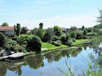 Ansicht des Parks von dem benachbarten Kanal - Bild 25: Sehr schönes Ferienhaus, jetzt € 50,- Rabatt jedes Wochenende bis Mai