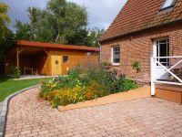 überdachte Sitzecke im Hintergrund links - Bild 4: mitten in d. Natur, modern,ruhiges Haus für 6 Pers. rollstuhlgerecht
