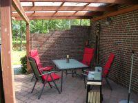 Auf der Terrasse kann man den Tag in Ruhe ausklingen lassen. - Bild 7: Ferienhaus LUKAS (vorm. Holl) in Dornum