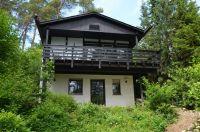 Das Ferienhaus Eifelröschen mit Blick auf die große Veranda und überdachte Sonnenterrasse - Bild 1: Ferienhaus Eifelröschen - wenn Sie das Besondere lieben