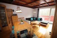 Blick von der offenen Küche auf den Essbereich und den Wohnbereich - Bild 13: Wellness für Familie und Hund Ferienhaus an Ostsee und Schlei